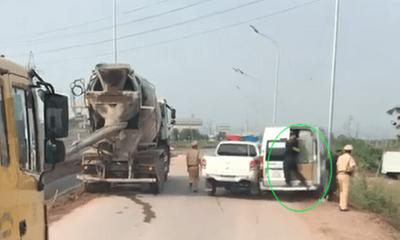 Truy tìm ô tô 16 chỗ hất CSGT xuống khỏi xe, bỏ chạy trên cao tốc Hà Nội - Bắc Giang
