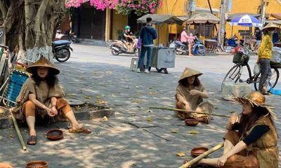 Truy tìm nhóm người giả ăn xin ở phố cổ Hội An quay video tung lên mạng