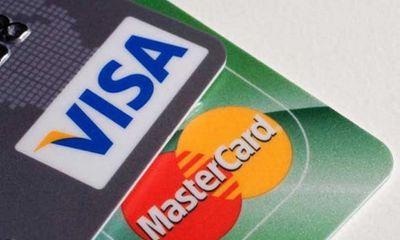 Visa và MasterCard thu 'phí chồng phí' với một giao dịch