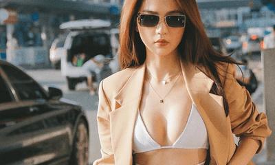 """Diện bikini khoe vòng 1 nóng bỏng tại sân bay, Ngọc Trinh """"đốt mắt"""