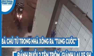 Video: Bà chủ từ trong nhà xông ra