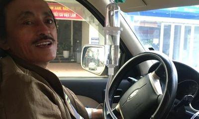 Nghệ sĩ Giang Còi tự lái xe trong lúc truyền nước gây hoang mang