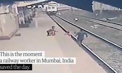 Video: Công nhân đường sắt cứu em bé khỏi đường ray trong gang tấc khi tàu lao tới