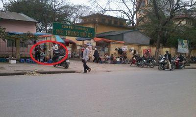 Hỗn chiến bằng súng trước cổng bệnh viện Thanh Nhàn
