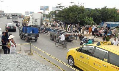 Nam thanh niên bị xe container cán chết vì vấp phải ổ gà
