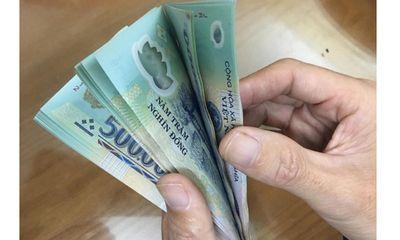 Giải đáp thắc mắc: Tờ 500.000 đồng bị rách làm đôi, có đến ngân hàng đổi được không?