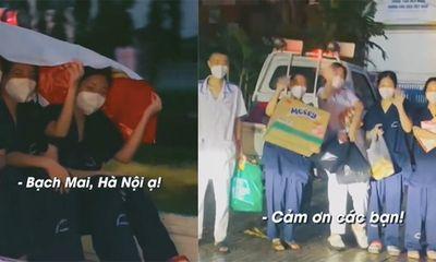 Clip: Nhóm sinh viên Hà Nội chống dịch co ro trên thùng xe giữa cơn mưa lớn khiến nhiều người xót xa