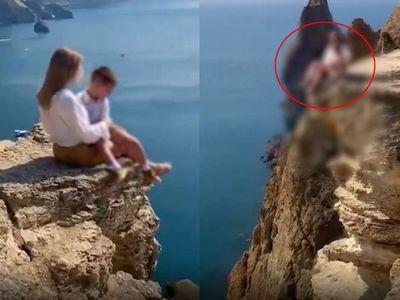 Người phụ nữ dẫn con trai lên vách đá tạo dáng chụp ảnh, dân mạng gay gắt đòi